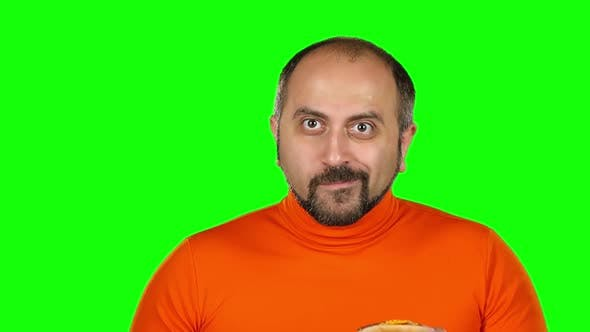 Thumbnail for Man with Overweight Is Played with Burgers, Green Screen. Slow Motion