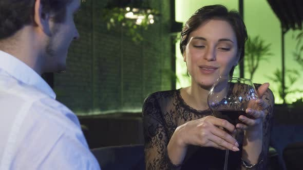 Thumbnail for Gorgeous Dark Haired Woman Drinking Wine During the Date with Her Boyfriend