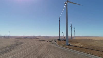 Contractors working on wind turbine