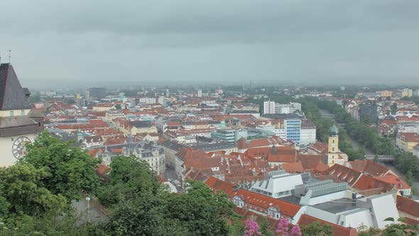 Thumbnail for Panoramic Moving View on Austrian Graz City From Famous Schlossberg Castle Hill in Rainy Weather