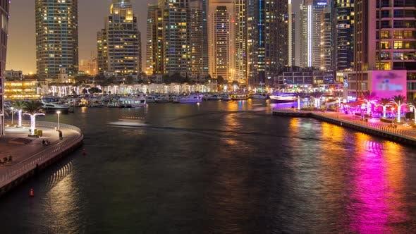 Dubai Marina Water Canal Night Time Lapse. Pan Up