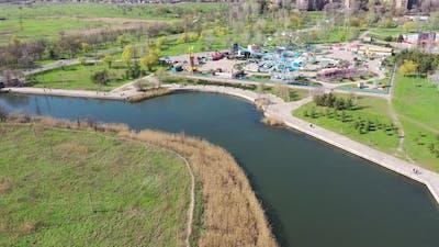 Amusement park on the river bank. City landscape.