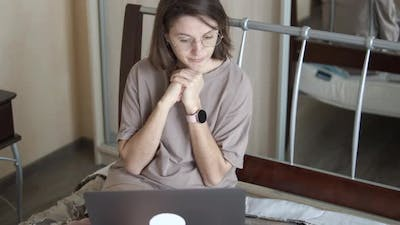 Freelancer Girl Working Remotely at Home