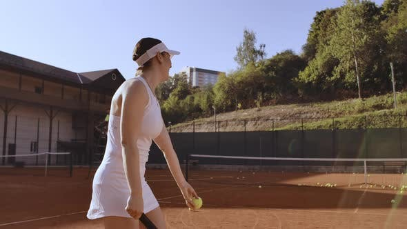 Thumbnail for Tennis Player Prepares To Serve Ball During Tennis Match