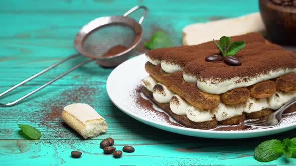 Thumbnail for Two Portions of Classic Tiramisu Dessert and Savoiardi Cookies on Blue Wooden Background