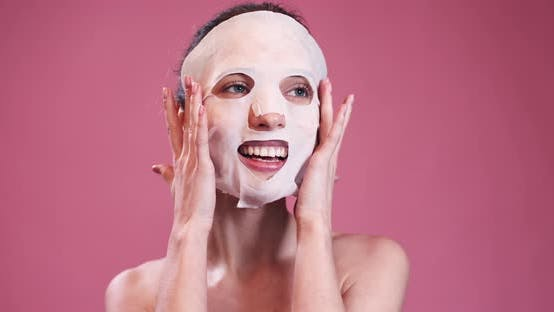 Thumbnail for Smiling Girl with White Moisturizing Face Mask