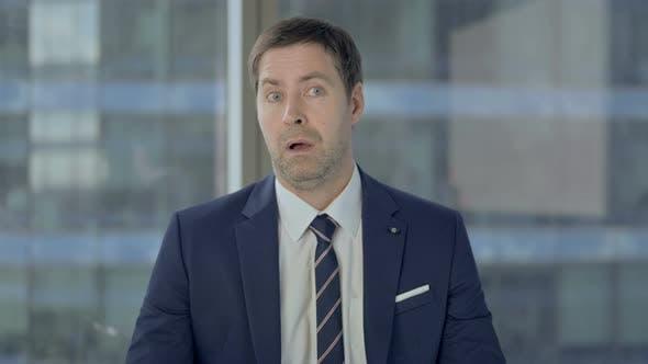 Shocked Businessman Wondering in Awe