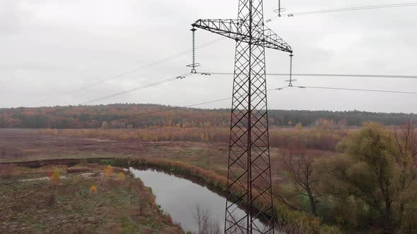 Transmission electricity steel pylon tower in forest. Electric tower lines. High voltage power pylon