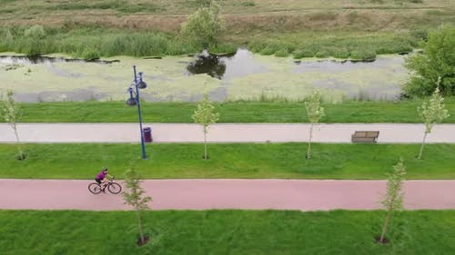 Professional athlete is practicing on road bike outdoor. Female triathlete is pedaling on bike