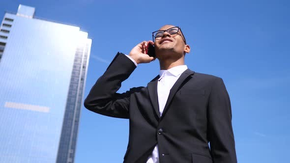 Thumbnail for Businessman Talking By The Smartphone. Diversity, Business, Technology, People