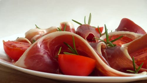 Jamon with tomatoes and rosemary.