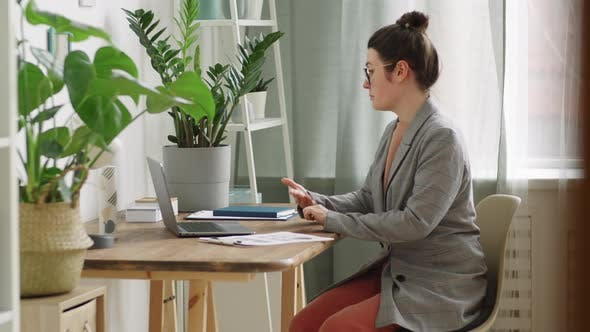 Thumbnail for Woman Having Business Meeting via Web Call on Laptop while Working Remotely