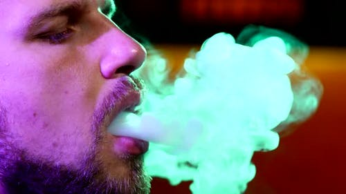 Close-up of Man with a Beard Smoking Traditional Hookah