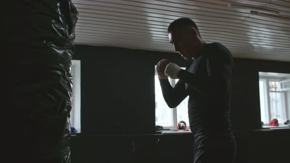 Sportsman Using Punching Bag