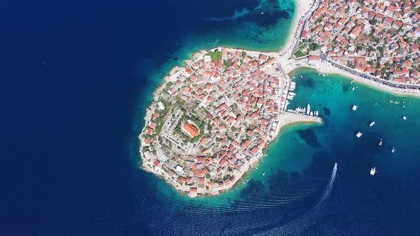 Thumbnail for Aerial view of speedboat passing Primosten peninsula, Croatia
