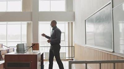 University Professor Giving Lecture at Blackboard