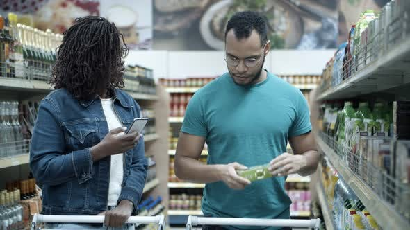 Thumbnail for Happy African American Couple Making Purchases in Grocery Store