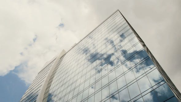 Thumbnail for Skyscraper Reflect Clouds in Glass Timelapse