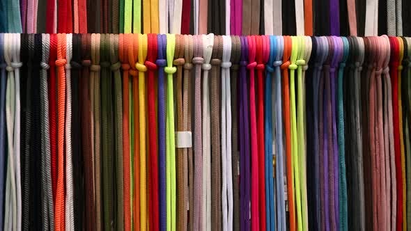 Lots of Multicolored Textile Ropes Hang in Several Rows