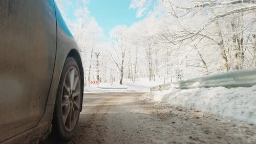 C Ar Wheels Driving On Snowy Countryside Road