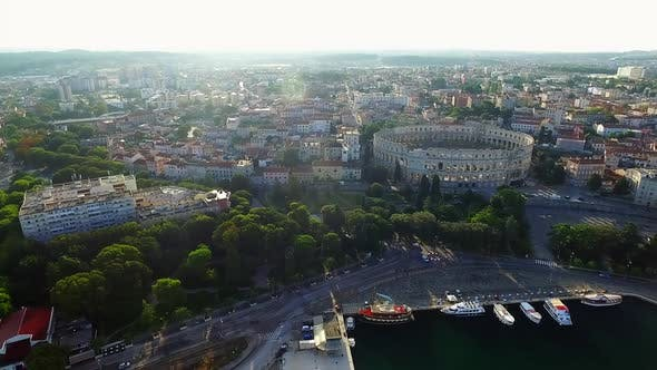 Pula amphitheatre and panorama of the city in the morning