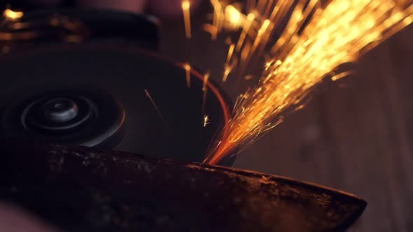 Thumbnail for Man Sharpen Axe with Grinder in the Dark with Flying Sparks