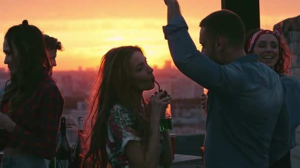 Thumbnail for Young Couple Hanging Out at Rooftop Party