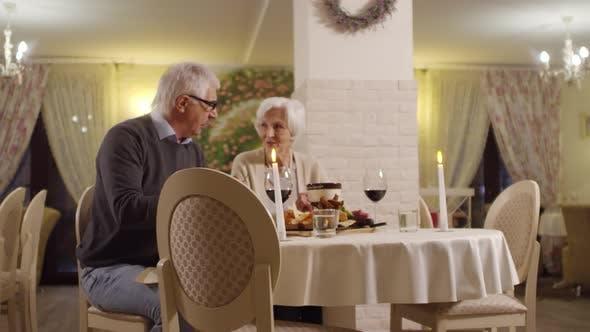 Thumbnail for Senior Caucasian Couple Drinking Red Wine in Hotel Restaurant