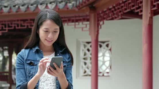 Thumbnail for Woman use of mobile phone in Chinese garden