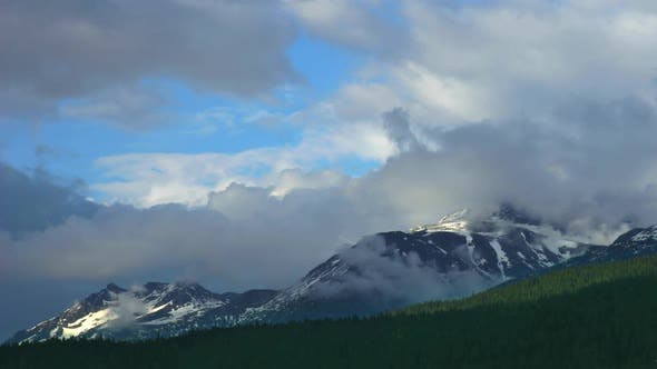 Thumbnail for Clouds Over The Mountains Time Lapse