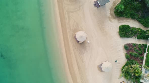 Thumbnail for Aerial view of an empty beach with white parasol, U.A.E.
