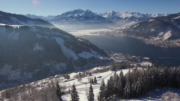 Thumbnail for Aerial shot of Zell am See with Lake Zell on a winter day