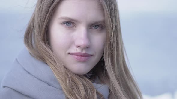 Thumbnail for Portrait of Beautiful Young Blond Woman with Long Hair and Blue Eyes Looking in the Camera
