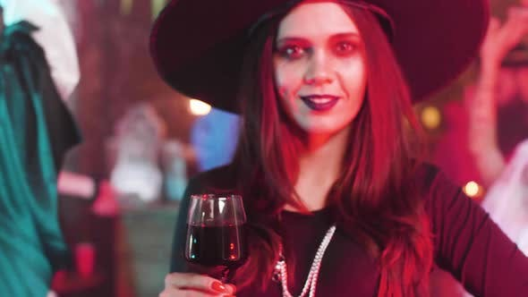 Thumbnail for Attractive Woman with a Beautiful Smile Disguised As Witch at a Halloween Party
