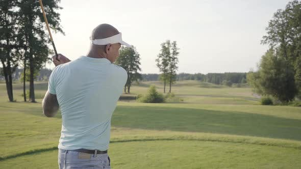 Thumbnail for Portrait Handsome Successful Middle Eastern Golfer Swinging and Hitting Golf Ball