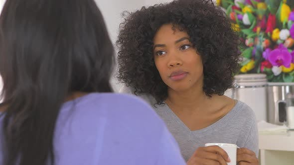 Thumbnail for Two African American friends having serious conversation at caf_