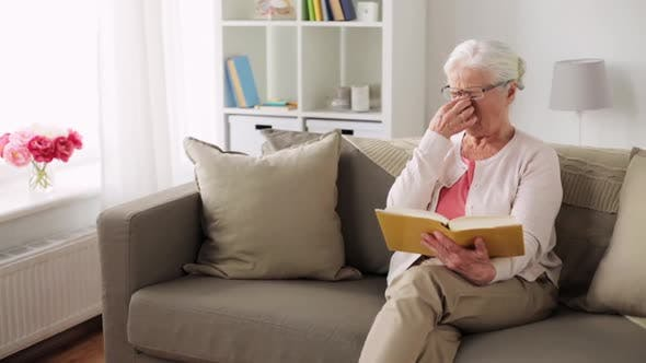 Thumbnail for Senior Woman in Glasses Reading Book at Home