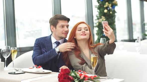 Romantic Pastime of Young Caucasian Couple in Restaurant.