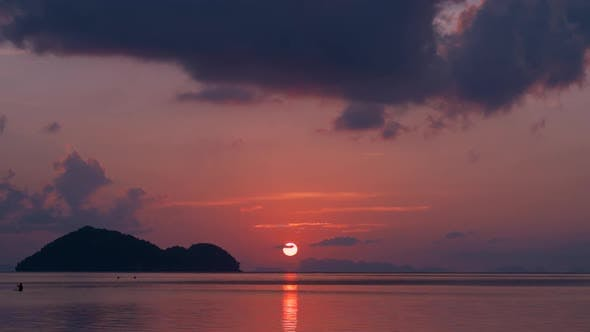 Thumbnail for Timelapse. Silhouette of Tropical Island at Sunset in Koh Phangan Island, Thailand