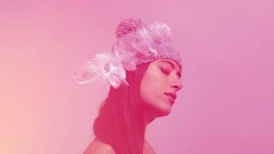 Woman Posing and Dancing in Knitwear Hat