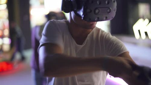 Modern Interactive Technologies, Man in Glasses of Virtual Reality Playing a Arcade Game, a Man