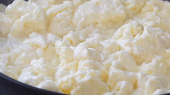 Thumbnail for Cooking Scrambled Eggs on Frying Pan Closeup