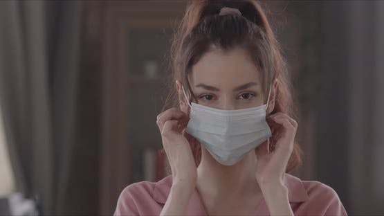 Happy Woman Takes Off The Surgical Mask From Her Face And Throws It Away