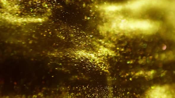 Thumbnail for Golden Ink in Water Shooting with High Speed Camera. Gold Drops of Paint Dropped, Reacting, Creating