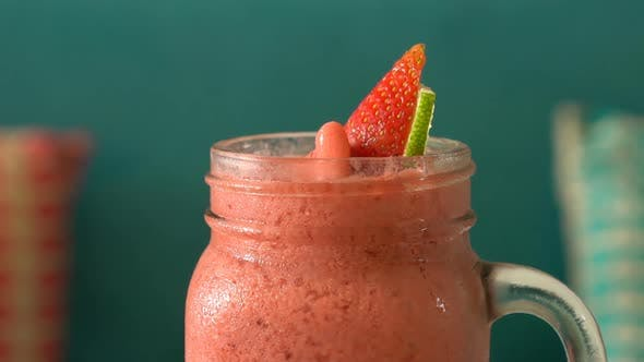 Thumbnail for Fresh Tropical Organic Strawberry Smoothie Rotate on Table.