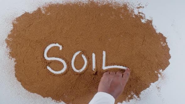Hand Writes On Soil  Soil