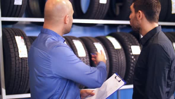 Thumbnail for Customer and Salesman at Car Service or Auto Store