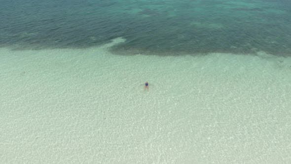 Thumbnail for Aerial: Woman on White Sand Beach Turquoise Water Tropical Coastline Caribbean Sea
