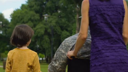 Disabled Serviceman and Family Together in Park, Rehabilitation Care and Support