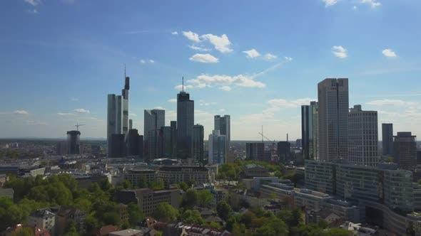 Thumbnail for AERIAL: Flying Towards Beautiful Frankfurt Am Main Skyline with Blue Sky and Sun Shining